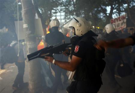 Riot police enter Gezi Park at Taksim Square in Istanbul